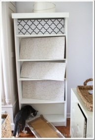Fabric covered boards in the bookcase make it easy to change when you want.