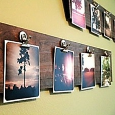 Easy way to decorate, a simple board stained with clips that are made to look like a clip board.