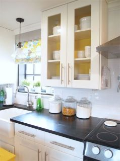 If you've got glass doors on your cabinets, paint the inside to add some color.