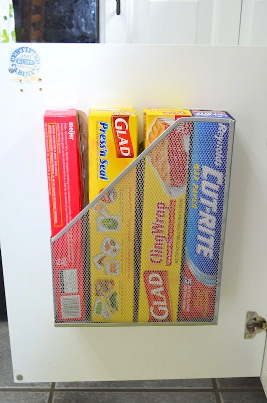 5.-Use-A-Magazine-Rack-To-Store-Kitchen-Wrap-12-Easy-Kitchen-Organization-Tips-
